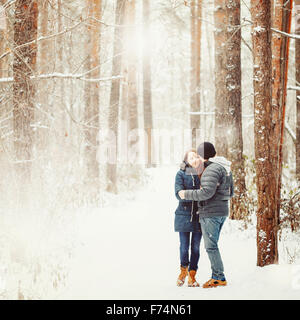 Young Couple Embracing in Winter Forest. Winter Vacations. Weekend Getaway. Space for Text. Natural Colors, Selective - Stock Photo