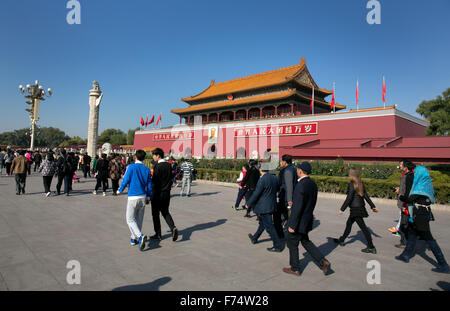 Tourists walk toward entrance to The Forbidden City at Tiananmen gate in Beijing, China. - Stock Photo