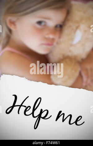 Composite image of close-up portrait of a girl with stuffed toy - Stock Photo