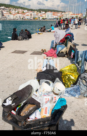 Syrian migrants fleeing the war and escaping to Europe,  who have landed on the Greek island of Lesvos on the north - Stock Photo