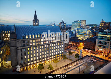 Manchester skyline showing the rooftops and central library and the town hall extension    tower light shaft rays - Stock Photo