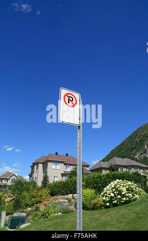 No parking sign in a rich suburban neighborhood - Stock Photo