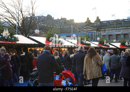 Edinburgh Christmas market in East Princes Street Gardens, with the castle behind, on a sunny, winter's day, in - Stock Photo