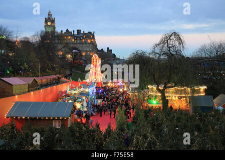The beautiful Edinburgh German Christmas market in East Princes Street Gardens, at dusk, in Scotland, UK - Stock Photo