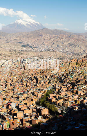 The peak of Illimani (6348 metres) from El Alto above, La Paz, Bolivia. La Paz and El Alto are critically short - Stock Photo