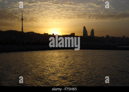 Baku Television Tower (left) and Baku Towers (right) silhouetted as the sun sets outside of Crystal Hall. Baku2015. - Stock Photo