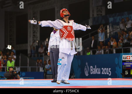 Aykhan Taghizade (AZE, red) celebrates after defeating Alexey Denisenko (RUS, blue). Taekwondo Men's 68kg Semi Final. - Stock Photo