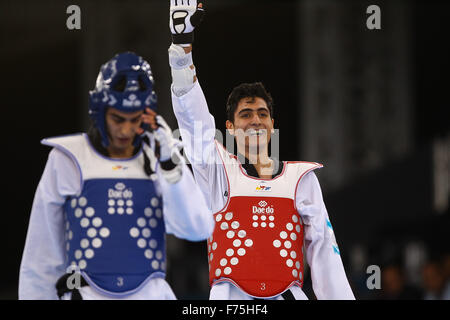 Aykhan Taghizade (AZE), right, celebrates after beating Joel Gonzalez Bonilla (ESP), left. Taekwondo. Crystal Hall. - Stock Photo