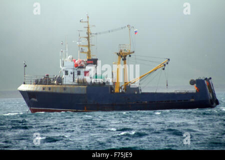 Fishing trawler during a storm in Pacific ocean near Commander Islands. Kamchatka - Stock Photo