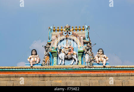 Roof ridge detail with typical colourful Hindu deity carvings, Kapaleeswarar Temple, a Hindu temple of Shiva in - Stock Photo