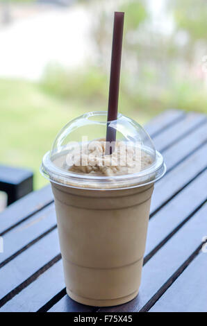 Milk coffee smoothie in plastic cup - Stock Photo