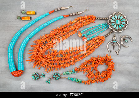 A collection of Vintage Native American Jewelry made of turquoise, silver and branch coral. - Stock Photo