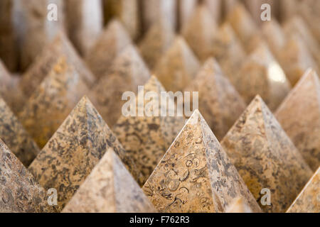 stone pyramids clustered in a pattern to fill the frame creating an interesting  background - Stock Photo