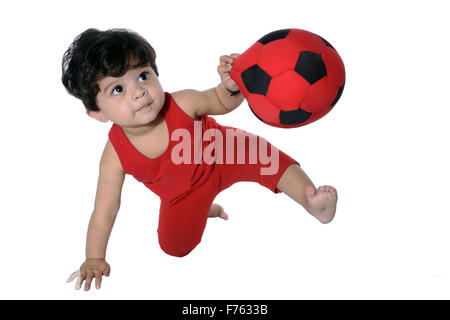 Baby boy playing with ball - Stock Photo