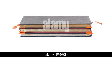 Stack of diaries isolated on a white background - Stock Photo