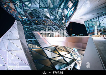 Exterior of BMW Welt at night, in Munich, Germany. - Stock Photo