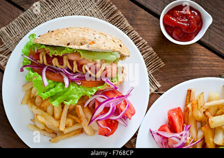 Hot Dogs - sandwich with French fries on white plate - Stock Photo