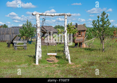 Children swings made from the trunks of birch - Stock Photo