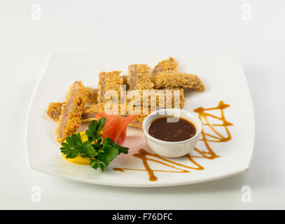 Sliced fish sticks and souce - Stock Photo