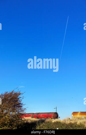 Railway carriages and jet trail, Middlesbrough - Stock Photo