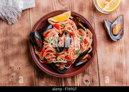 spaghetti with mussels oyster in tomato sauce - Stock Photo