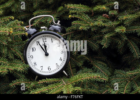 Christmas: Vintage alarm clock a New Year tree. - Stock Photo