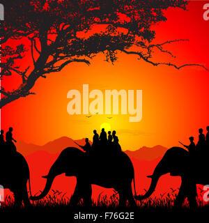 silhouette of wildlife safari on an elephant - Stock Photo