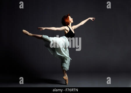 Ballet dancer performing on stage - Stock Photo