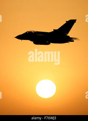 (dpa file) A German Air Force handout file picture dated 2007 of a Tornado jet fighter against the setting sun in - Stock Photo