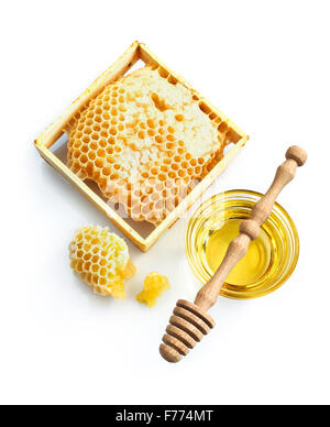 Honeycomb with fresh honey and dipper isolated over white - Stock Photo