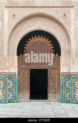 Richly decorated portal, Medersa Ali Ben Youssef , Marrakech, Morocco - Stock Photo