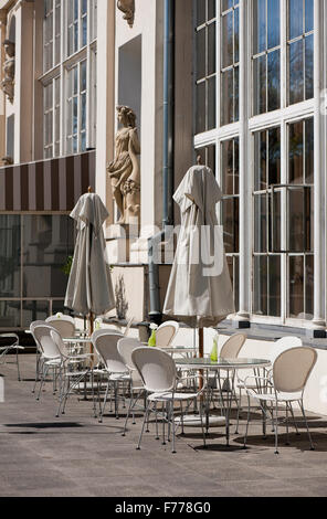 empty restaurant chairs tables and umbrellas waiting for guest on stock photo royalty free. Black Bedroom Furniture Sets. Home Design Ideas