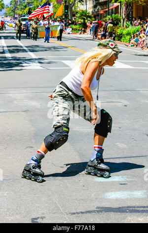 A roller-blading MASH blond does her thing down State Street in Santa Barbara on July 4th - Stock Photo