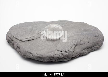 Quartz pebble on a big stone - Stock Photo