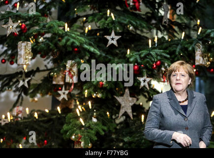 Berlin, Germany. 26th Nov, 2015. German Chancellor Angela Merkel attends the annual inauguration of the three Christmas - Stock Photo