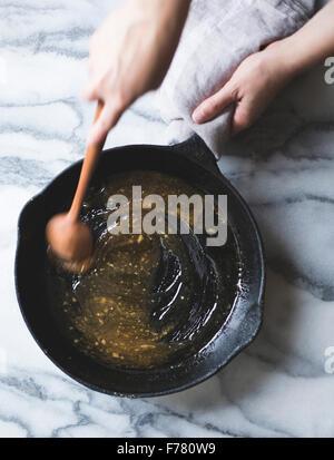Mixing sauce in a pan - Stock Photo