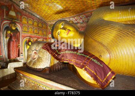 Sri Lanka - Buddish Cave Temple Dambulla, Buddha statue detail, UNESCO World Heritage Site - Stock Photo