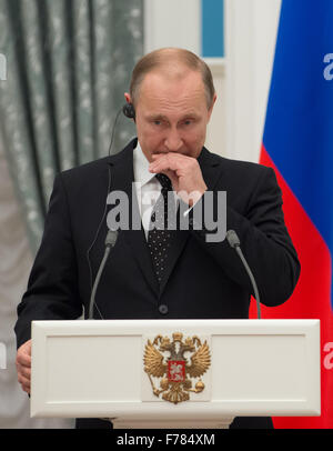 Moscow, Russia. 26th Nov, 2015. Russian President Vladimir Putin reacts during a joint press conference with his - Stock Photo