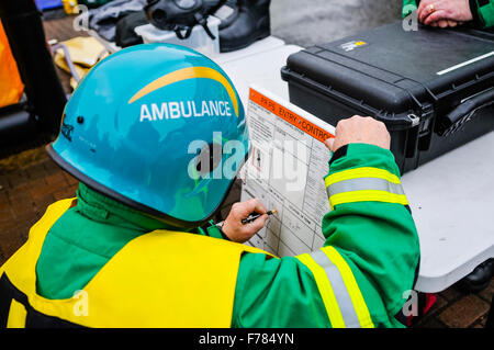 Northern Ireland. 26th November, 2015. An incident officer with the Northern Ireland Ambulance Service updates a - Stock Photo