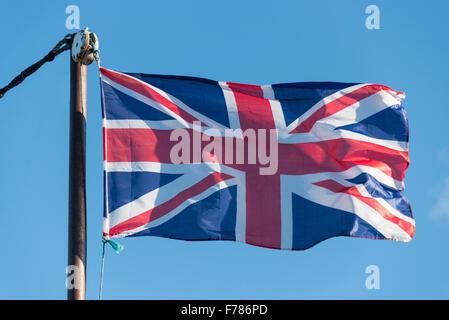 Union Jack flag flying on flagpole, Faversham Creek, Faversham, Kent, England, United Kingdom - Stock Photo