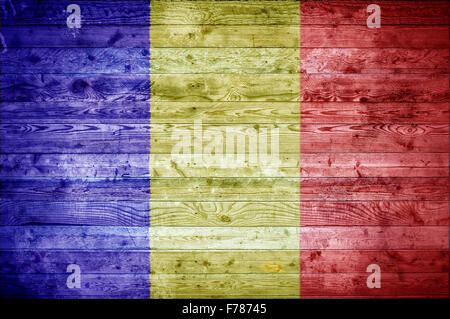 A vignetted background image of the flag of Chad painted onto wooden boards of a wall or floor. - Stock Photo