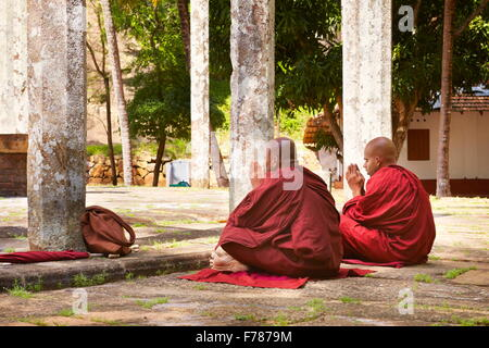 Sri Lanka - monks praying at Mihintale Temple, Ambasthale Dagoba, UNESCO - Stock Photo
