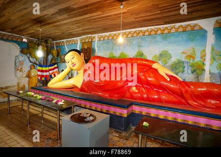 Sri Lanka - Mihintale Temple, Buddha statue inside a temple, UNESCO World Heritage Site - Stock Photo
