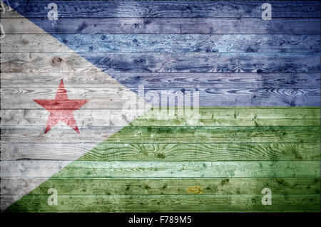 A vignetted background image of the flag of Djibouti painted onto wooden boards of a wall or floor. - Stock Photo