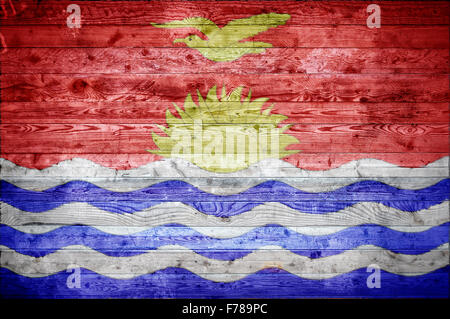 A vignetted background image of the flag of Kiribati painted onto wooden boards of a wall or floor. - Stock Photo