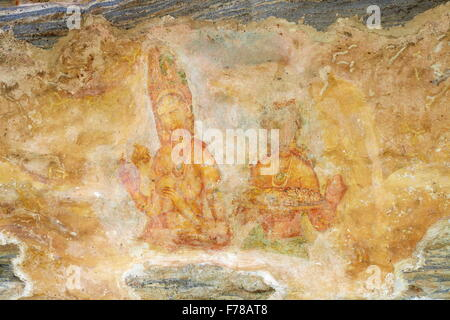 Sri Lanka - ancient frescoes, cave wall paintings inside Sigiriya fortress, UNESCO World Heritage Site - Stock Photo
