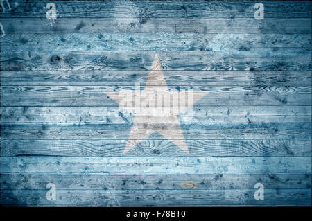 A vignetted background image of the flag of Somalia onto wooden boards of a wall or floor. - Stock Photo