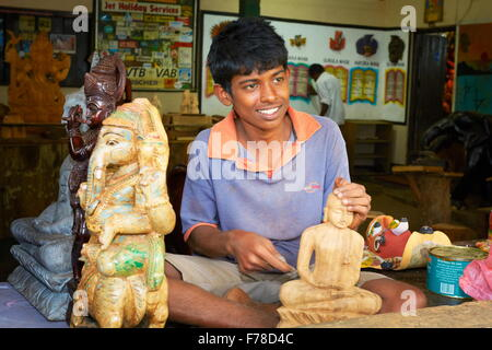 Sri Lanka - portrait of young worker, traditional wood carving - Stock Photo
