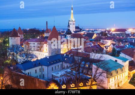 Tallinn old town overview lighted at dusk. Tallinn, Estonia - Stock Photo