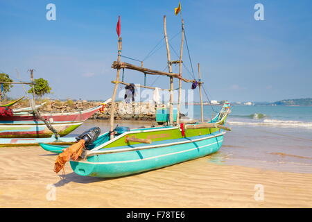 Sri Lanka - Galle,  traditional wooden painted fishing boats in the port - Stock Photo